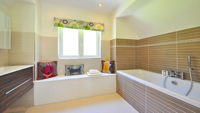 clean bathroom with a big tub