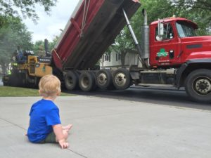a child looking at construction workers